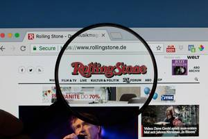 Rolling Stone logo on a computer screen with a magnifying glass