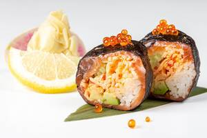 Rolls with nori, salmon, crab, rice, avocado, tobik caviar, salmon caviar and micro-greens (Flip 2019)