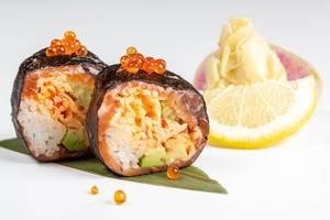 Rolls with nori, salmon, crab, rice, avocado, tobik caviar, salmon caviar and micro-greens