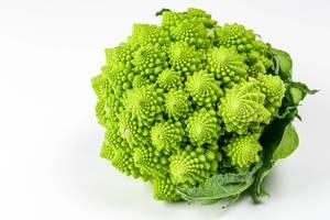 Romanesco broccoli cabbage (or Roman Cauliflower) on white background (Flip 2020)