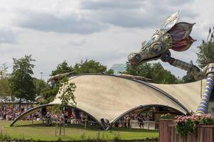 Rose Garden stage with an enormous metallic dragon at Tomorrowland festival