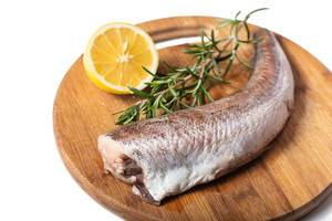 Rosemary and Lemon with Hake fish on the kitchen round cutting board