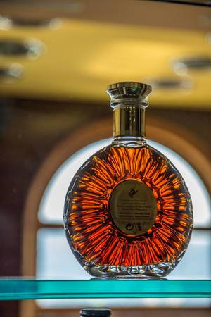 Round bottle in contra light on shelf in the bar.jpg