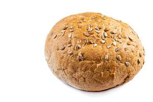 Round bread with Sunflower on the white background