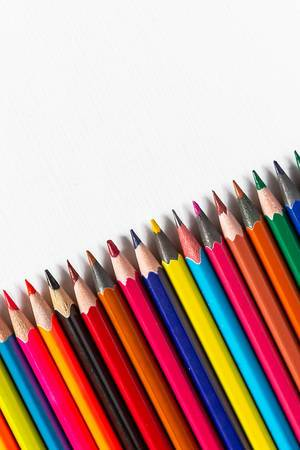 Row of colored pencils on white background (Flip 2019)