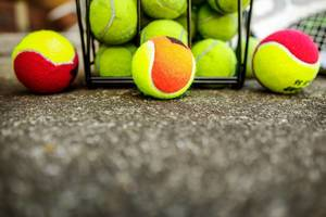 Row of kids tennis balls