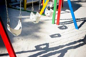 Row of swings for kids