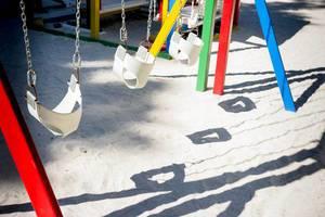 Row of swings for kids