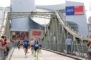 Runners at the Gerolsteiner Brückenlauf in Cologne, Germany
