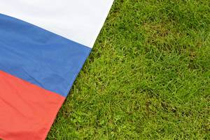 Russian flag on the grass