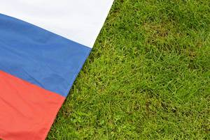 Russian national flag on grass symbolizes the world championship of soccer in russia