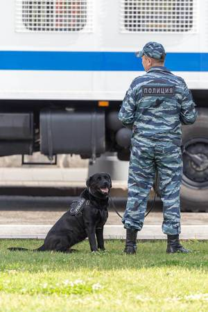 Russian officer with police dog