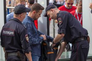 Russian police officers going through a Man