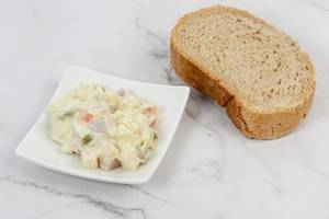 Russian Salad on the plate with bread (Flip 2019)