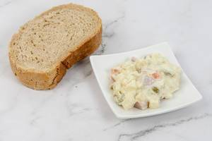 Russian Salad on the plate with bread