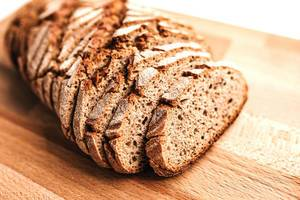 Rustic wholemeal rye bread on wooden board