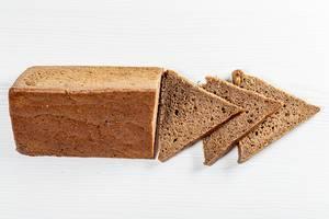 Rye bread triangular shape on white background (Flip 2019)