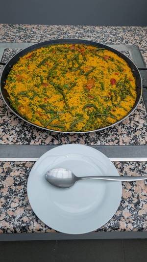 Saffron risotto with carrots, green bean and peas
