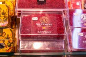 "Saffron Strands sold in a plastic box at a spice stand in Barcelonas most famous market hall ""Mercat de Sant Josep"", Spain"