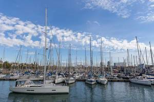 Sailboats at harbour Port Vell, next to promenade Rambla de Mar in Catalonia, Barcelona (Spain)