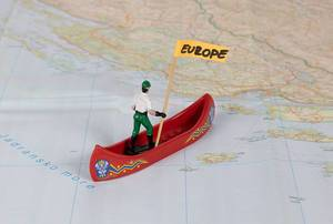 Sailor on course to Europe on a map as a symbol for the European refugee crisis