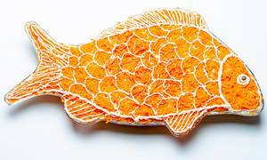 Salad layers in the shape of a fish on a white background (Flip 2020)
