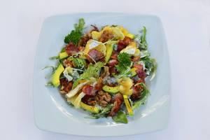 Salad of bacon, arugula, cheese and avocado