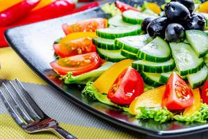 Salad with tomato pepper and cucumber, food close up  Flip 2019