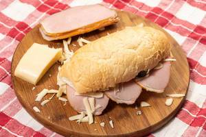 Sandwich with Ham and Cheese on the wooden board