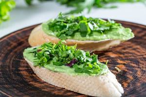 Sandwiches with avocado guacamole on plate (Flip 2019)