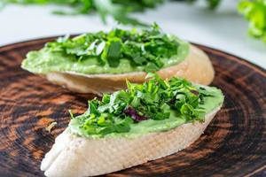 Sandwiches with avocado guacamole on plate