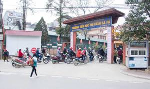 Sapa Vietnam School Entrance with Motocycle in front