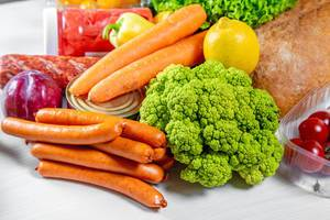 Sausages, broccoli, carrots, canned food, bread-ingredients for cooking