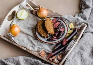 Sausages With Bread On Wooden Plate