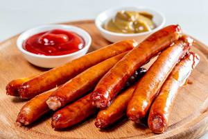 Sausages with two sauces on wooden kitchen Board (Flip 2019)