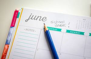 School Break Calendar With Blue Pencil