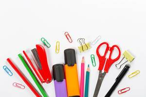 School supplies on white background. Markers, scissors, pencils and paper clips (Flip 2019)