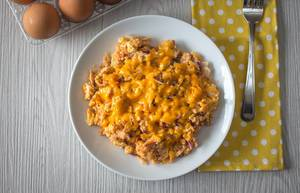 Scrambles eggs with cheese on top, bird view