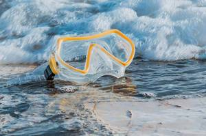 Scuba diving mask at the beach