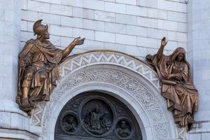 Sculptures on each side above the entrance to the Cathedral of Christ the Saviour