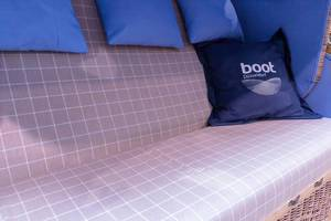 Seat of a beach basket with checkered cover and cushion of the fair boot Dusseldorf