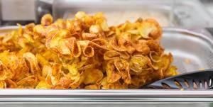 Self-made snack: baked potato crisps