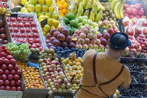 Seller checking his fruit at Danilovsky Market in Moscow