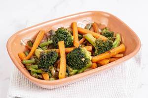 Served cooked Carrot with Green Beans Onions and Broccoli