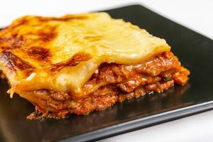 Served Lasagna on the black square plate (Flip 2019)