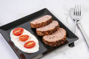Served Pork and Chicken Meat Loaf with Tomatoes (Flip 2019)