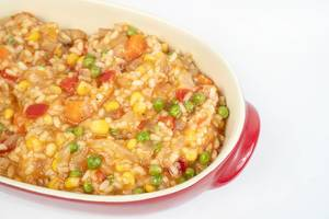 Served Risotto with Vegetables above white background (Flip 2019)