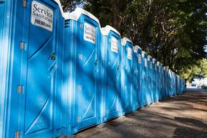 Service sanitation - mobile toilet cabins in a row