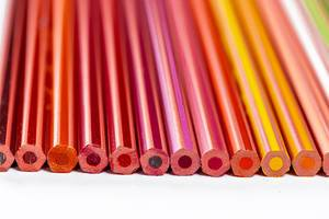Set of colored pencils of different shades of yellow, red and brown