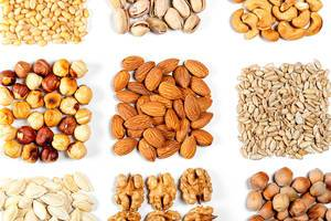 Set of nuts and seeds on white. Concept of natural healthy nutrition (Flip 2020)